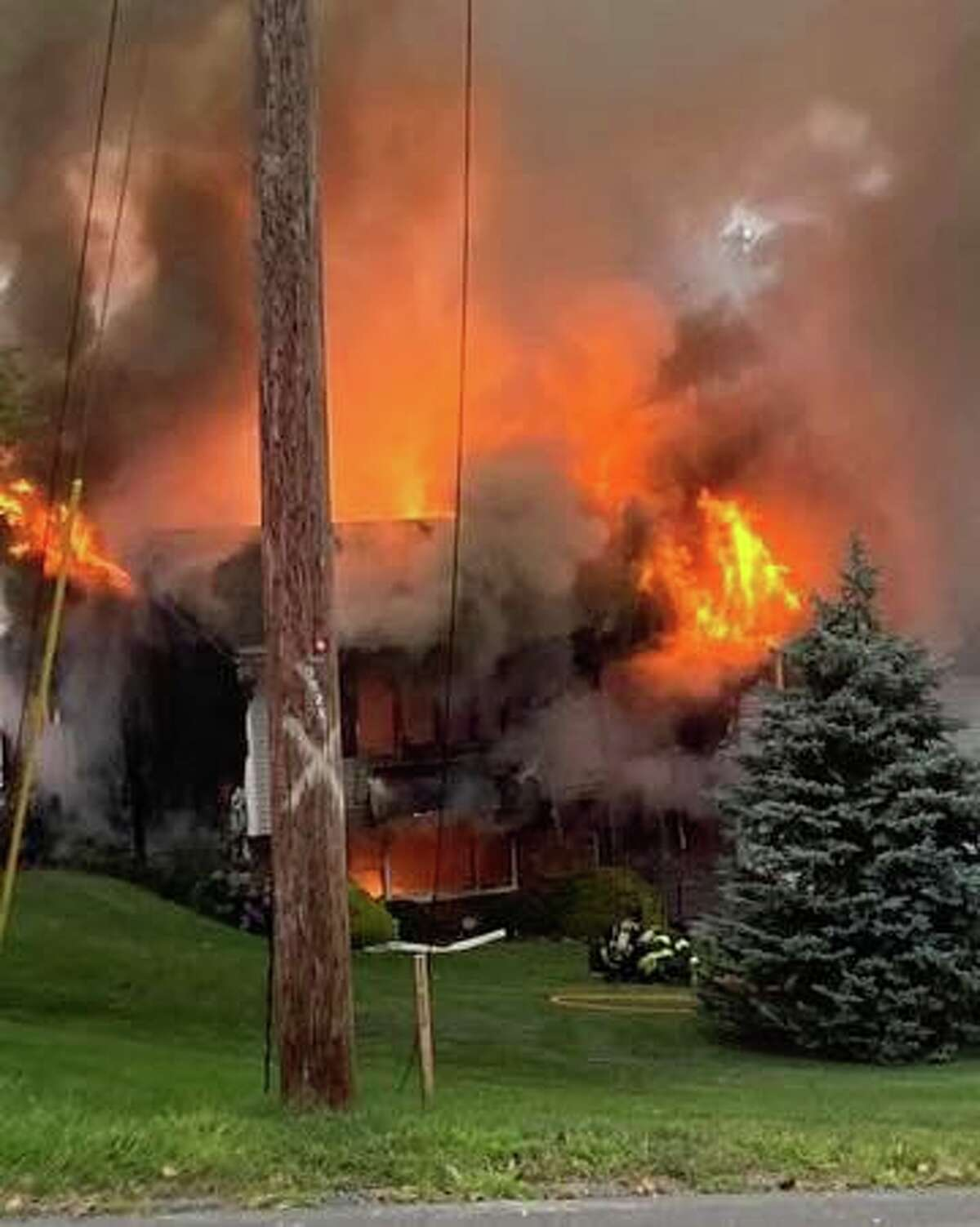 A fire at a Captains Hill Road in Monroe, Conn., on Thursday, Aug. 5, 2021.