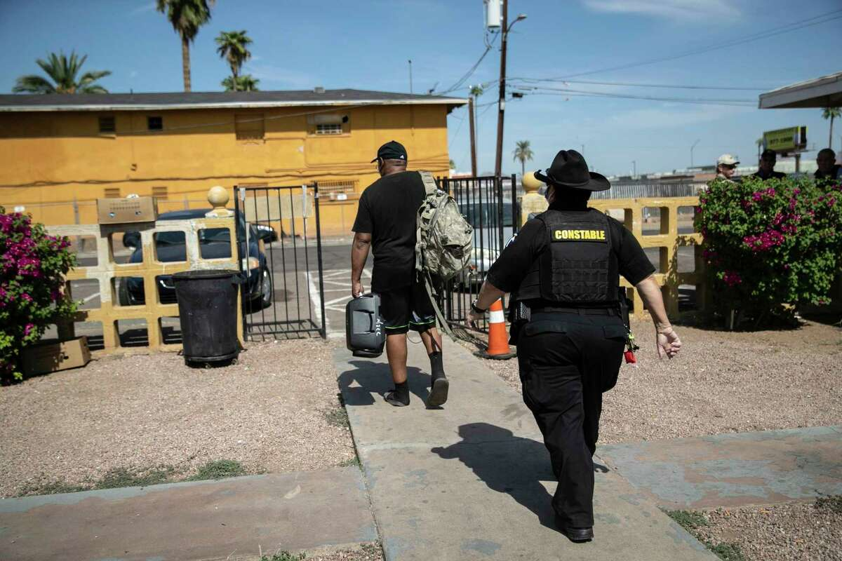 A Maricopa County constable evicts a tenant in October 2020 in Phoenix. (John Moore/Getty Images/TNS)