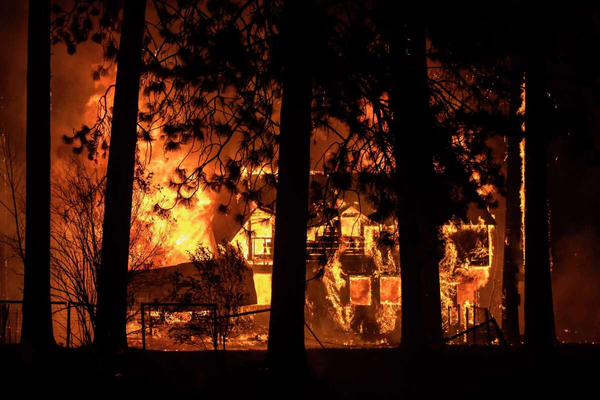 A property is engulfed in flames Wednesday along Interstate 89 during the Dixie Fire in Greenville (Plumas County).