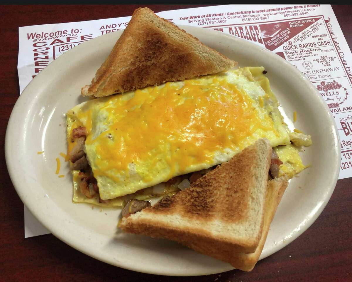 A bacon, ham and sausage omelet, complete with diced onions and tomatoes and some slices of Texas Toast. (Pioneer photo/Joe Judd)
