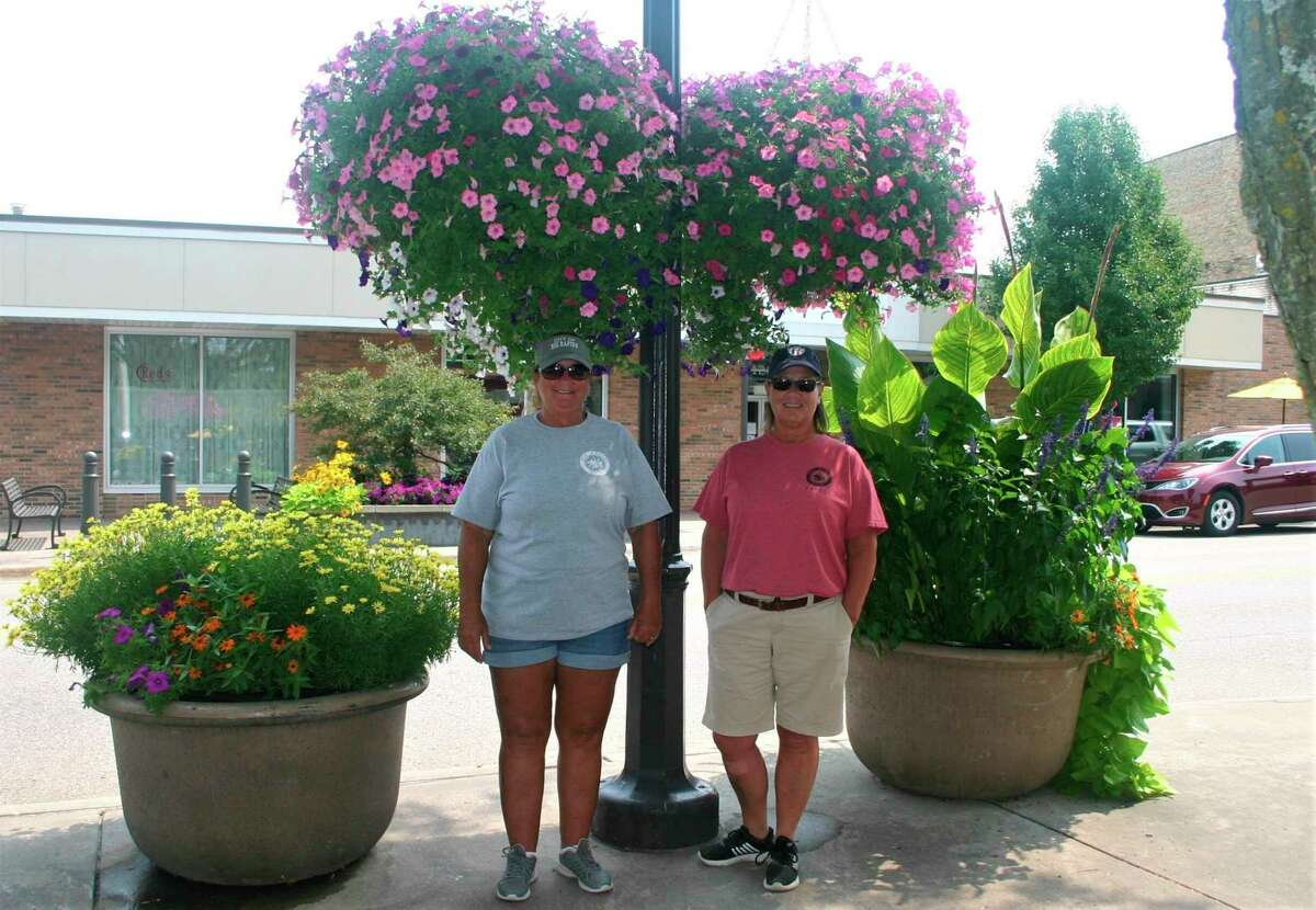 From left, Carla Wheeler andLeah Vander Slootwork together with the Big Rapids Parks Department to maintain and care for the flowers in the city. (Pioneer photo/Cathie Crew)