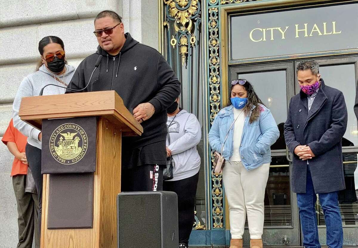 James Tofaeono, speaking at the podium, the father of a 16-year-old girl slain in San Francisco's Bayview District. The girl's family pleaded for peace, said they forgave their daughter's killer, while asking that person to surrender to police.