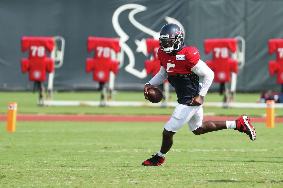 Houston Texans quarterback Tyrod Taylor runs out of the pocket during an NFL training camp football practice Thursday, Aug. 5, 2021, in Houston.