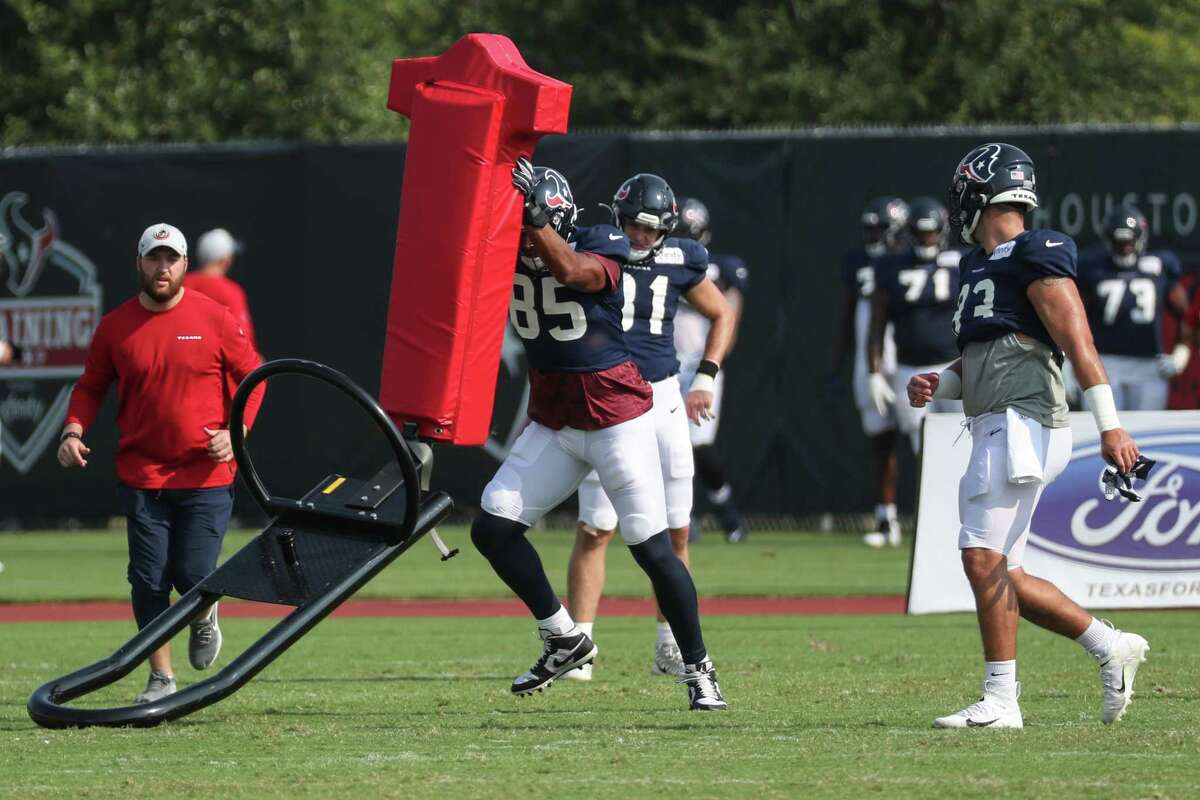 Houston Texans tight end Pharaoh Brown (85) hits a blocking sled during an NFL training camp football practice Thursday, Aug. 5, 2021, in Houston.