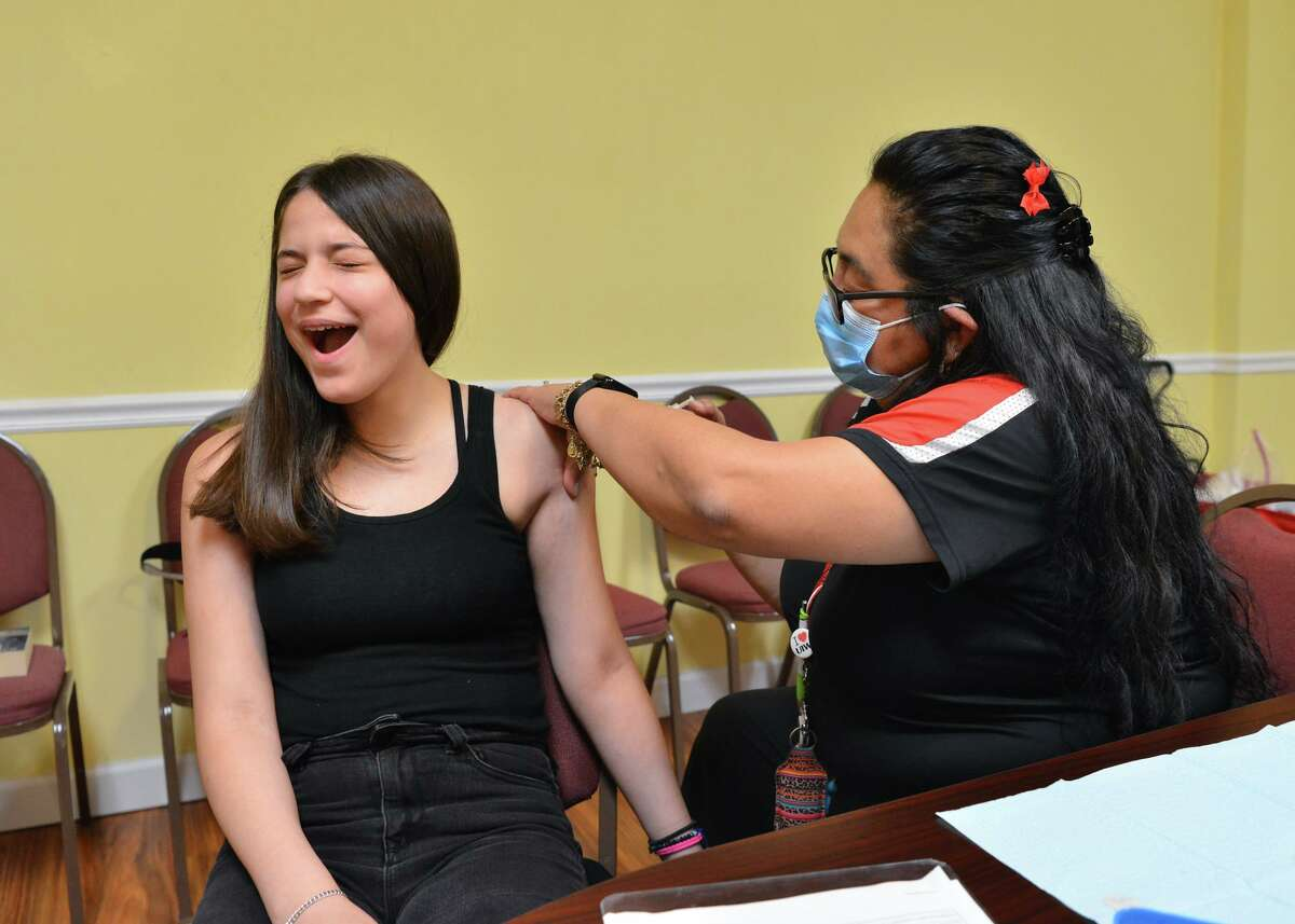 A teen receives a shot at a vaccine clinic hosted by University of the Incarnate Word at Greater Corinth Baptist Church. As health professionals find out more about the highly contagious delta variant, the community can use the lessons already learned to get through this surge.