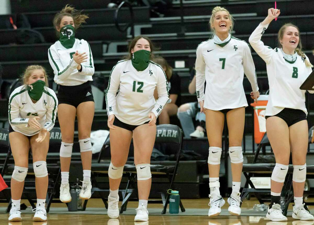 Kingwood Park volleyball players react after they score during the first set of a District 20-5A volleyball match against Montgomery at Kingwood Park High School in Kingwood.
