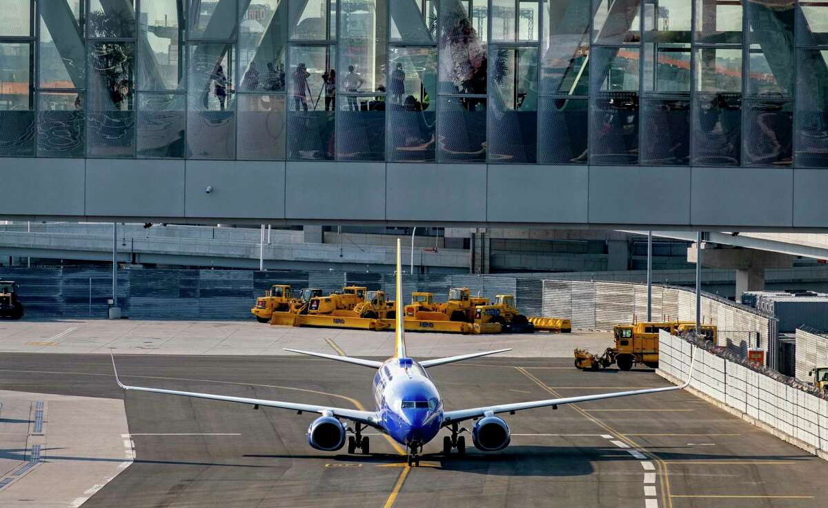 A Southwest jet moves at LaGuardia Airport in May 2021 in New York City. Despite a rebound in travel this spring, Booking Holdings absorbed another quarterly loss from its travel websites that include Booking.com, Kayak and Priceline. (AP Photo/Craig Ruttle)