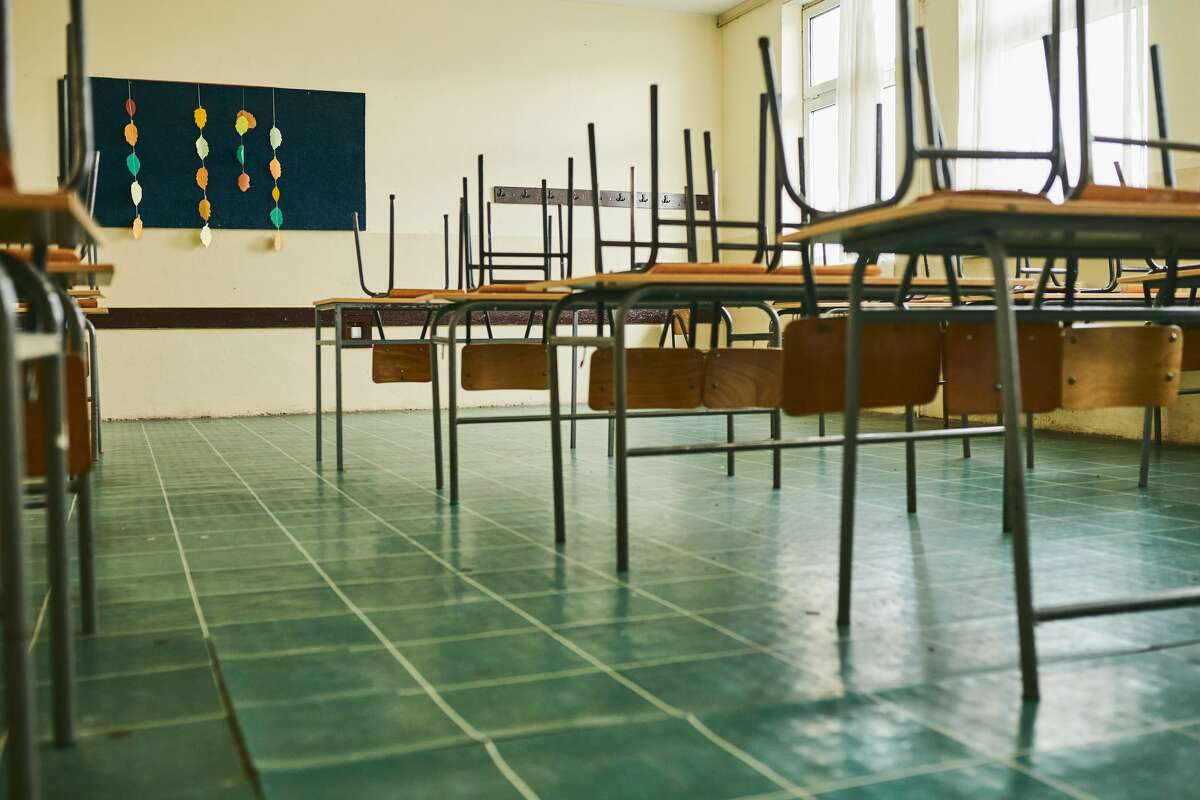 Empty classroom with chairs on the table during COVID-19 pandemic. At the core of the state guidelines is the use of multiple layers of protection in schools, as recommended by the CDC.
