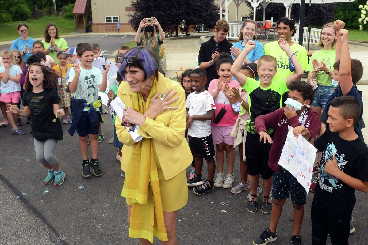 U.S. Rep. Rosa DeLauro is greeted by dozens of enthusiastic summer campers during a visit to the Sterling House Community Center, in Stratford, Conn. Aug. 5, 2021.