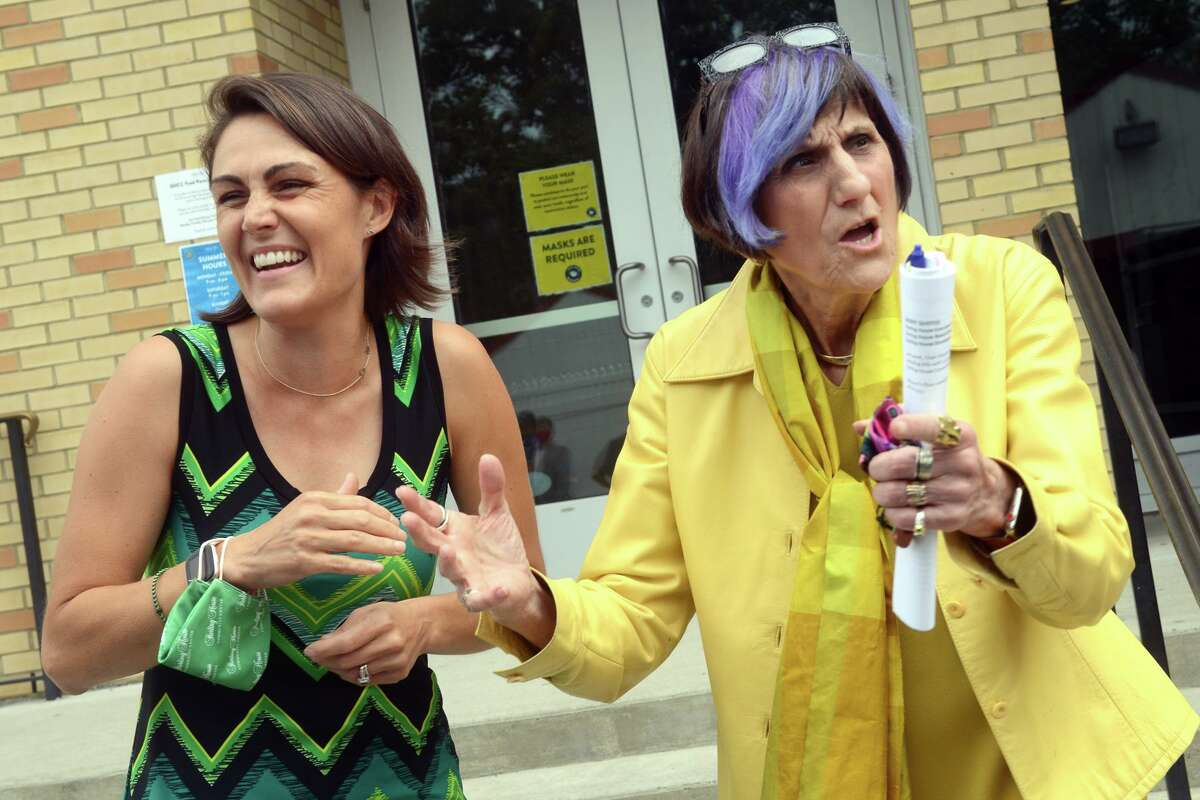 U.S. Rep. Rosa DeLauro, right, speaks with Executive Director Amanda Meeson during a visit to the Sterling House Community Center, in Stratford, Conn. Aug. 5, 2021.
