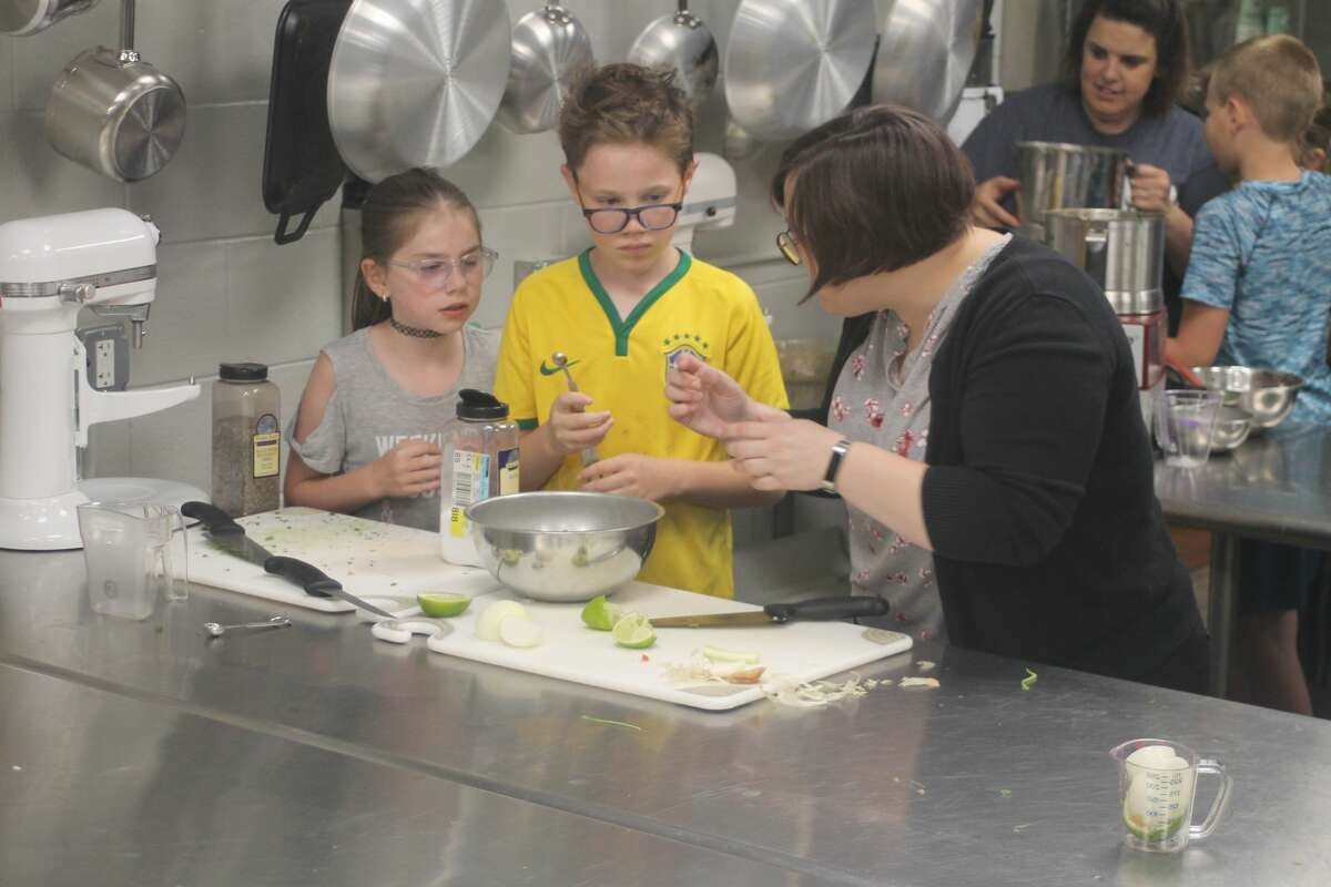 Students work on making salsa during West Shore Community College's College for Kids program on Wednesday.
