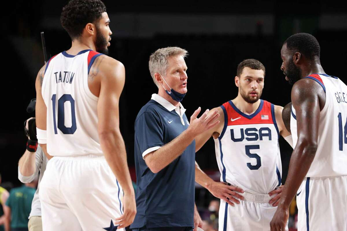 SAITAMA, JAPAN - AUGUST 05: Team United States Assistant Coach Steve Kerr speaks with Draymond Green #14 during the second half of a Men's Basketball quarterfinals game on day thirteen of the Tokyo 2020 Olympic Games at Saitama Super Arena on August 05, 2021 in Saitama, Japan. (Photo by Gregory Shamus/Getty Images)