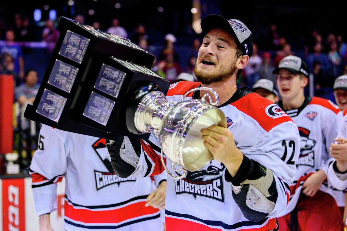 ROSEMONT, IL - JUNE 08: Charlotte Checkers right wing Julien Gauthier (12) celebrates after game five of the AHL Calder Cup Finals against the Chicago Wolves on June 8, 2019, at the Allstate Arena in Rosemont, IL. (Photo by Patrick Gorski/Icon Sportswire via Getty Images)