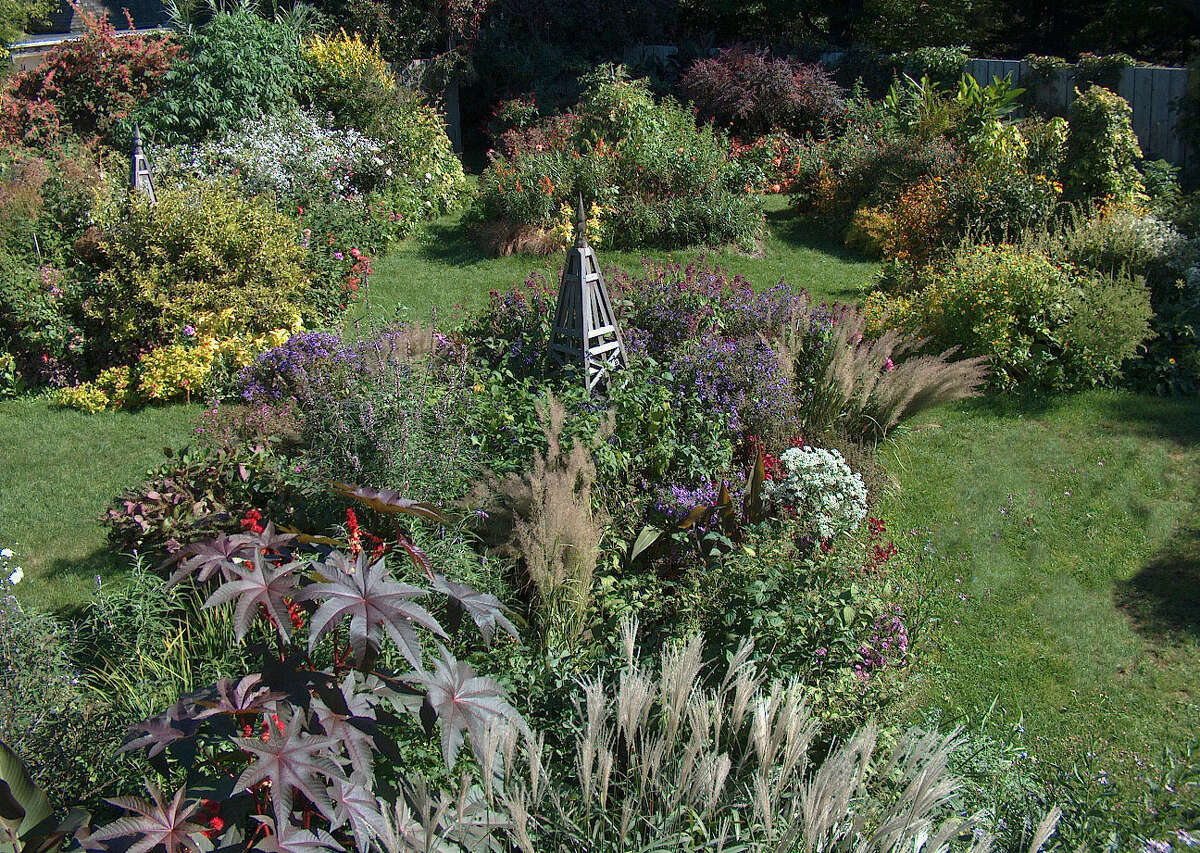 Stonecrop Gardens, with its alpine stone beds and cliff rock garden, woodland and water gardens, and enclosed English-style flower garden (pictured) is a garden enthusiast's wonderland.