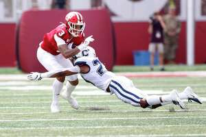 BLOOMINGTON, INDIANA - SEPTEMBER 21: Ty Fryfogle #3 of the Indiana Hoosiers is tackled by Omar Fortt #27 of the Connecticut Huskies at Memorial Stadium on September 21, 2019 in Bloomington, Indiana. (Photo by Justin Casterline/Getty Images)