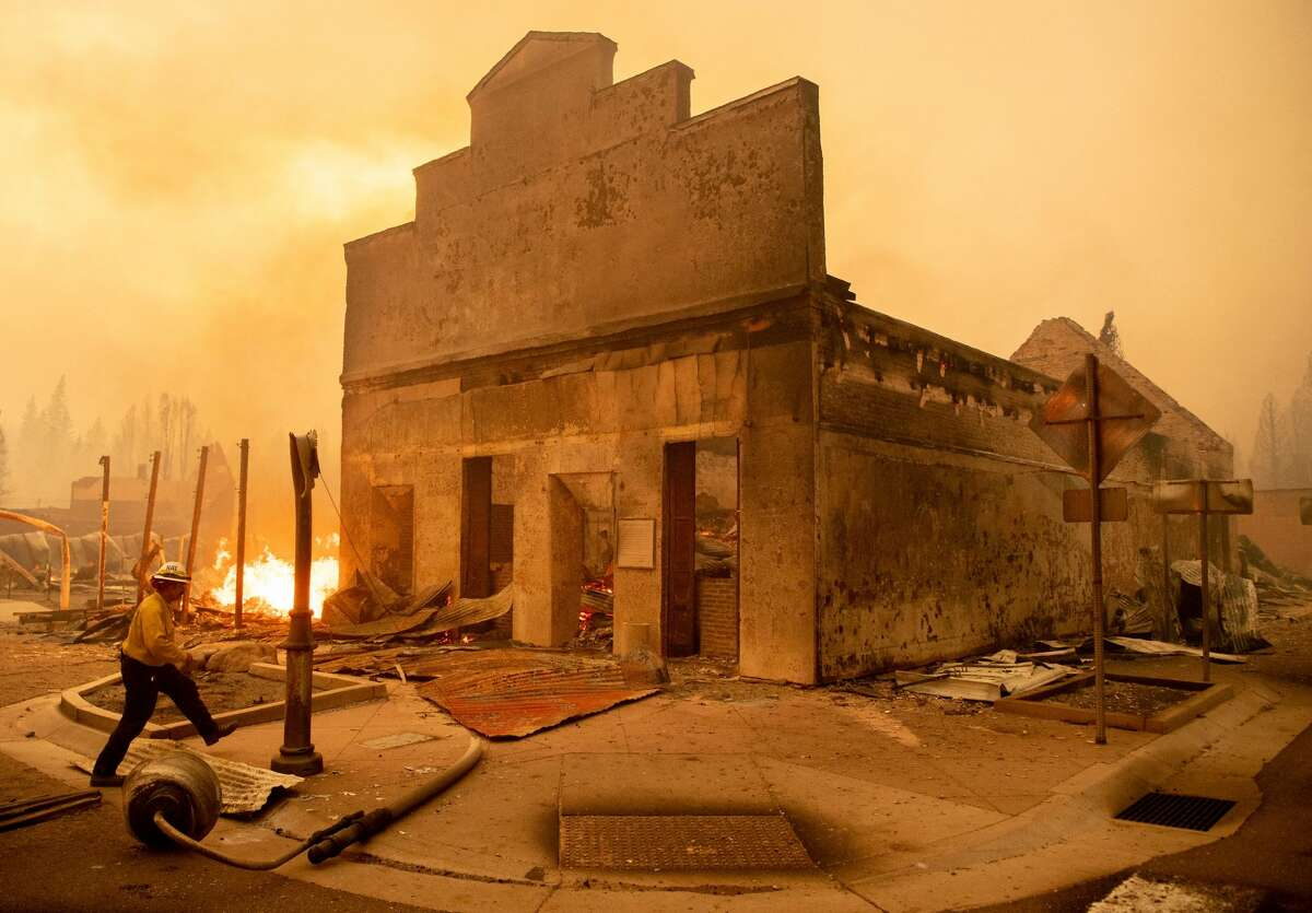 Battalion Chief Sergio Mora surveys a burned building as the Dixie Fire tears through downtown Greenville, California on August 4, 2021.