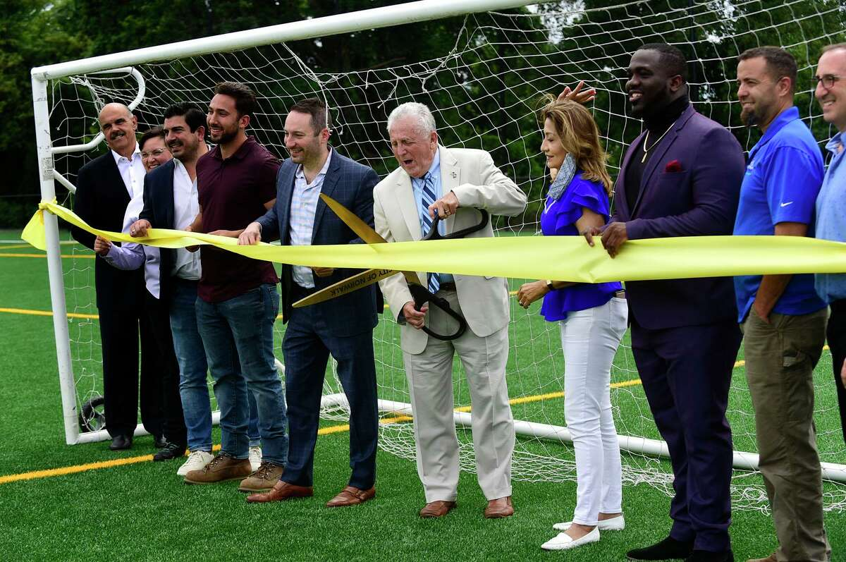 Dignitaries from Norwalk Public Schools, Parks & Rec, Public Works, Landtech, TD and Sons, and the Norwalk Junior Soccer Association join Mayor Harry Rilling for a ribbon cutting for the new West Rocks Soccer Complex Thursday, August 5, 2021, in Norwalk, Conn.