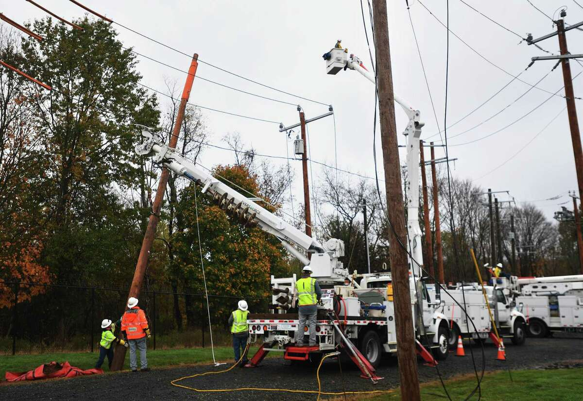 Eversource Energy workers demonstrate the steps involved in power restoration at the company's training site in Berlin Oct. 28, 2020.