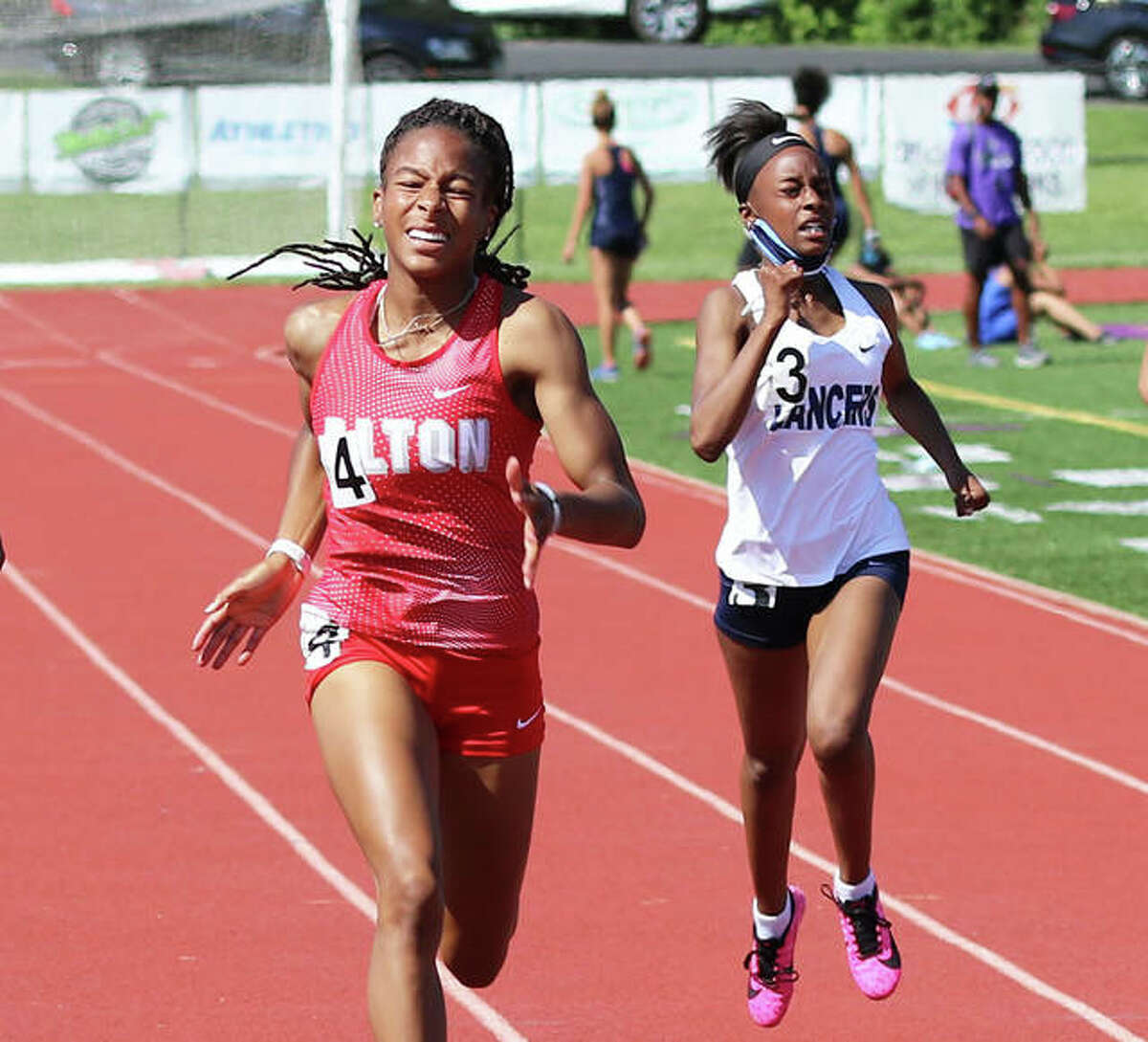 Alton junior Renee Raglin (left) wins the 200 meters to complete sprints sweep after winning the 100 at the SWC Meet on May 26 at Collinsville. Raglin is the 2021 Telegraph Large-Schools Girls Track Athlete of the Year.
