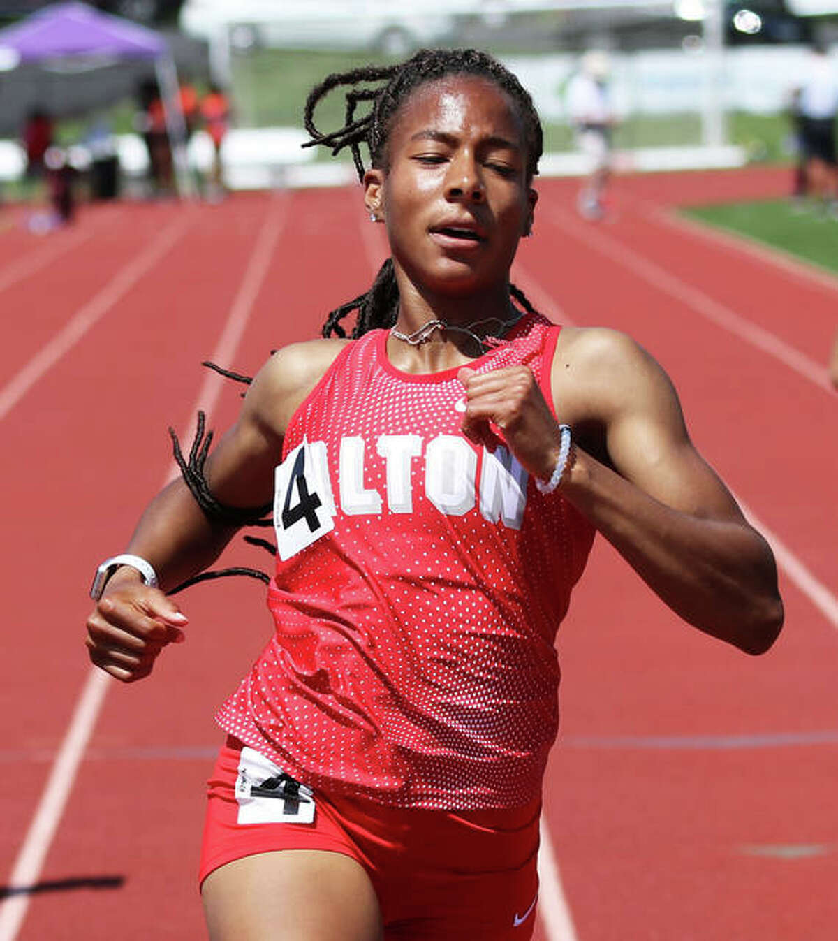 Alton's Renee Raglin crosses the finish line to win the 100 at the SWC Meet last season at Collinsville.