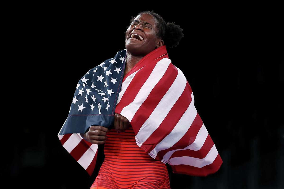 Tamyra Mariama Mensah-Stock of Team United States celebrates defeating Blessing Oborududu of Team Nigeria during the Women's Freestyle 68kg Gold Medal Match on day eleven of the Tokyo 2020 Olympic Games at Makuhari Messe Hall on Aug. 03, 2021, in Chiba, Japan.