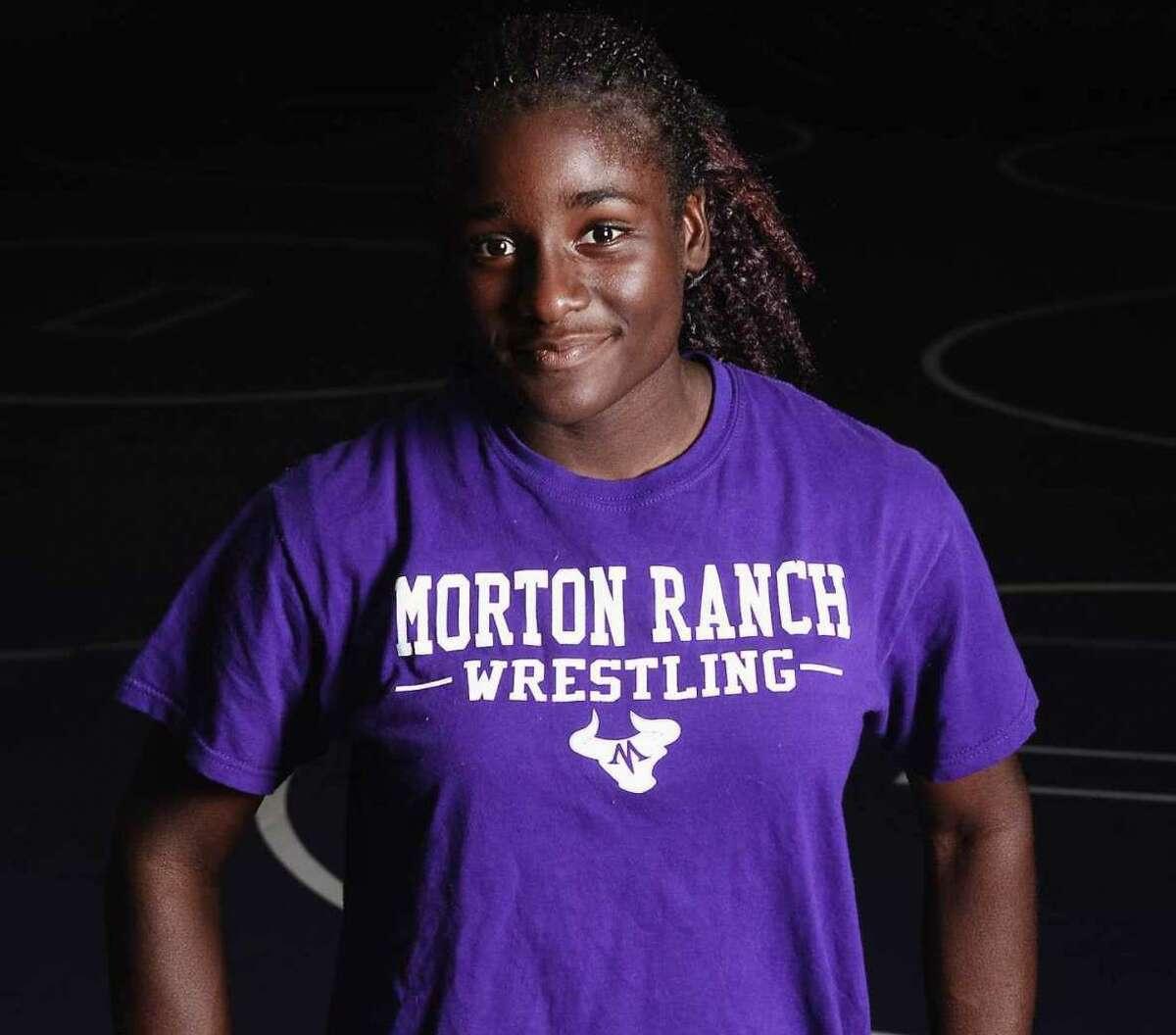 This photo shows Olympic gold medal wrestler Tamyra-Mensah Stock as a high school wrestler at Morton Ranch High School.