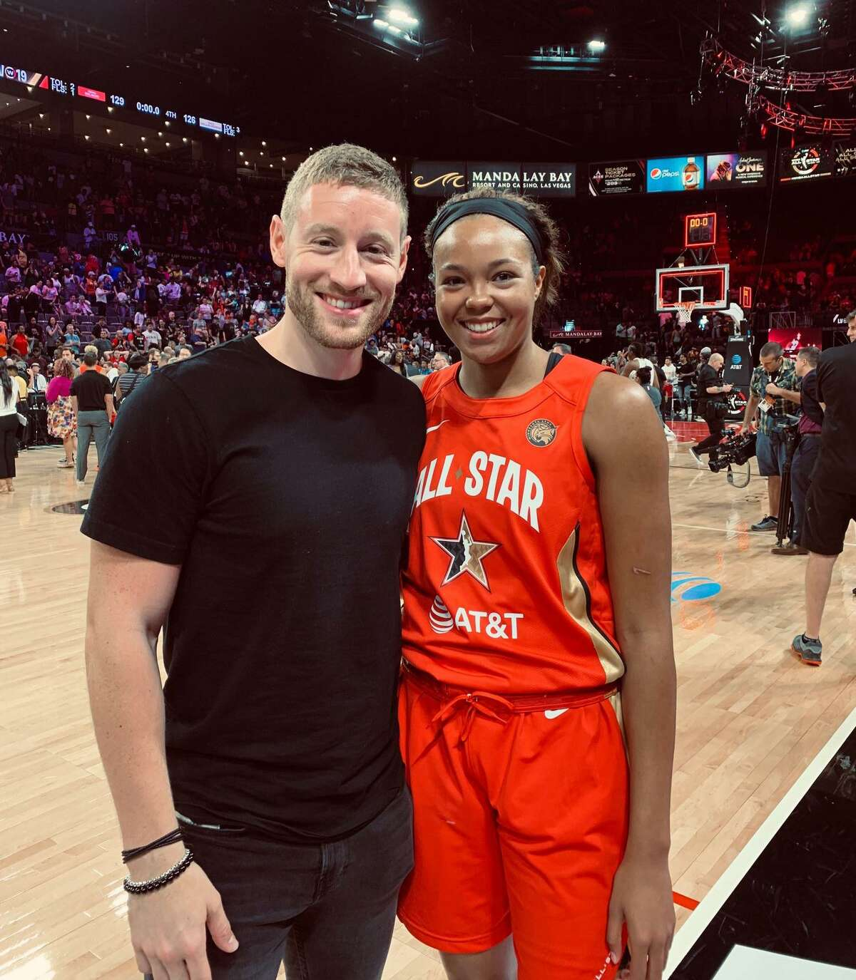 Basketball trainer Alez Bazzell, left, and his fiance, Lynx star Napheesa Collier at the WNBA All-Star game.