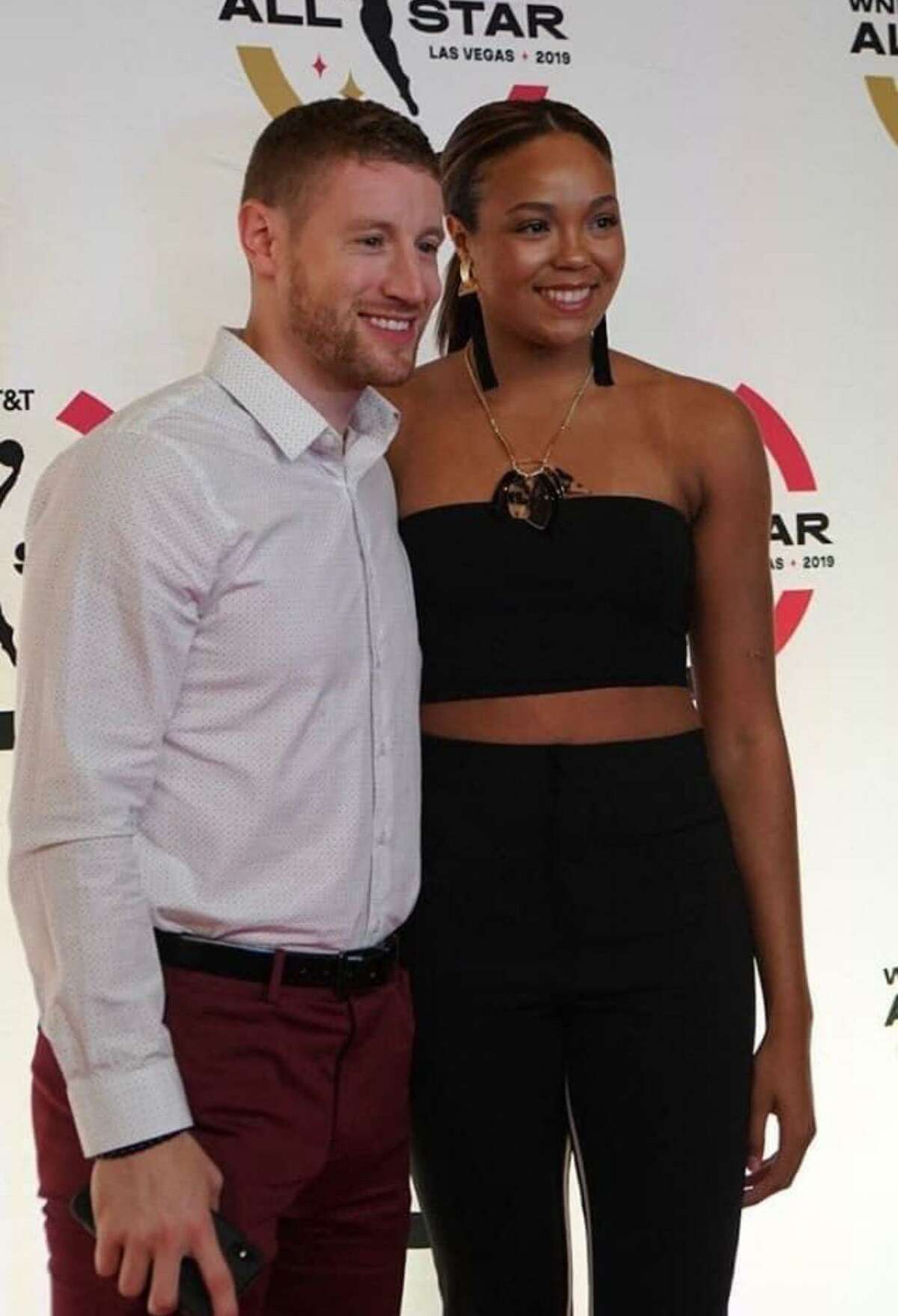 Basketball trainer Alex Bazzell, left, and his fiance, Lynx star Napheesa Collier, attend the 2019 WNBA All-Star game in Las Vegas.