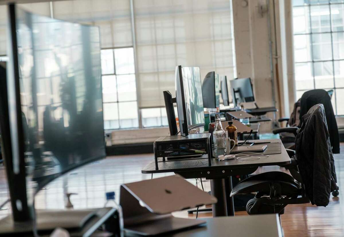 Workstations remain empty at the Fast office space in San Francisco in July. While working remotely has helped kept many of San Francisco's high-paid employees safe, it is having an ill effect on the city's tax revenue, potentially siphoning off millions of dollars per year.
