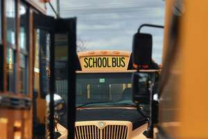 Buses in the First Student bus company lot on Middletown Avenue in New Haven, March, 2020.