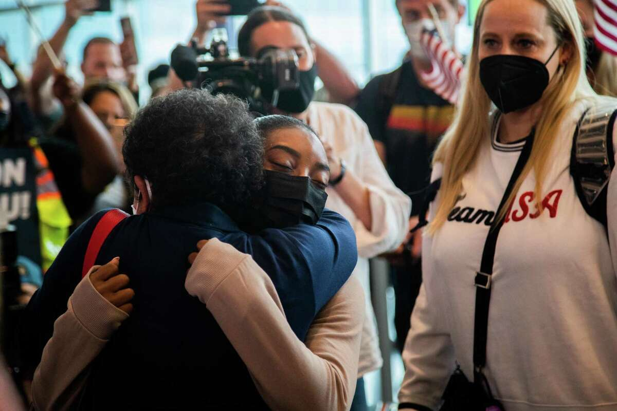 Olympic medalist Simone Biles arrives to the George Bush Intercontinental Airport, Thursday, Aug. 5, 2021, in Houston. Biles won two Olympic medals during the Tokyo 2020 Olympics.