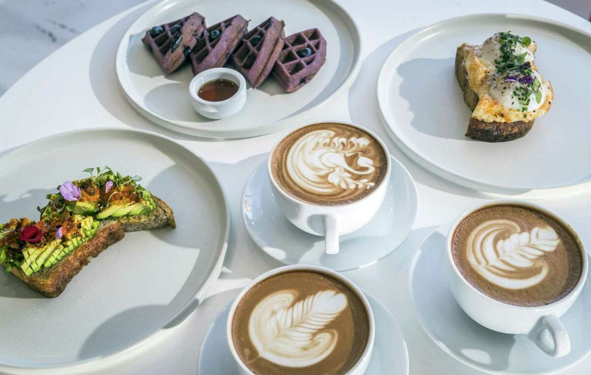"""Clockwise from far left: Spro's """"umami bomb"""" avocado toast, blueberry mochi waffles, toast with sous vide eggs, and coco de mer mocha drinks."""