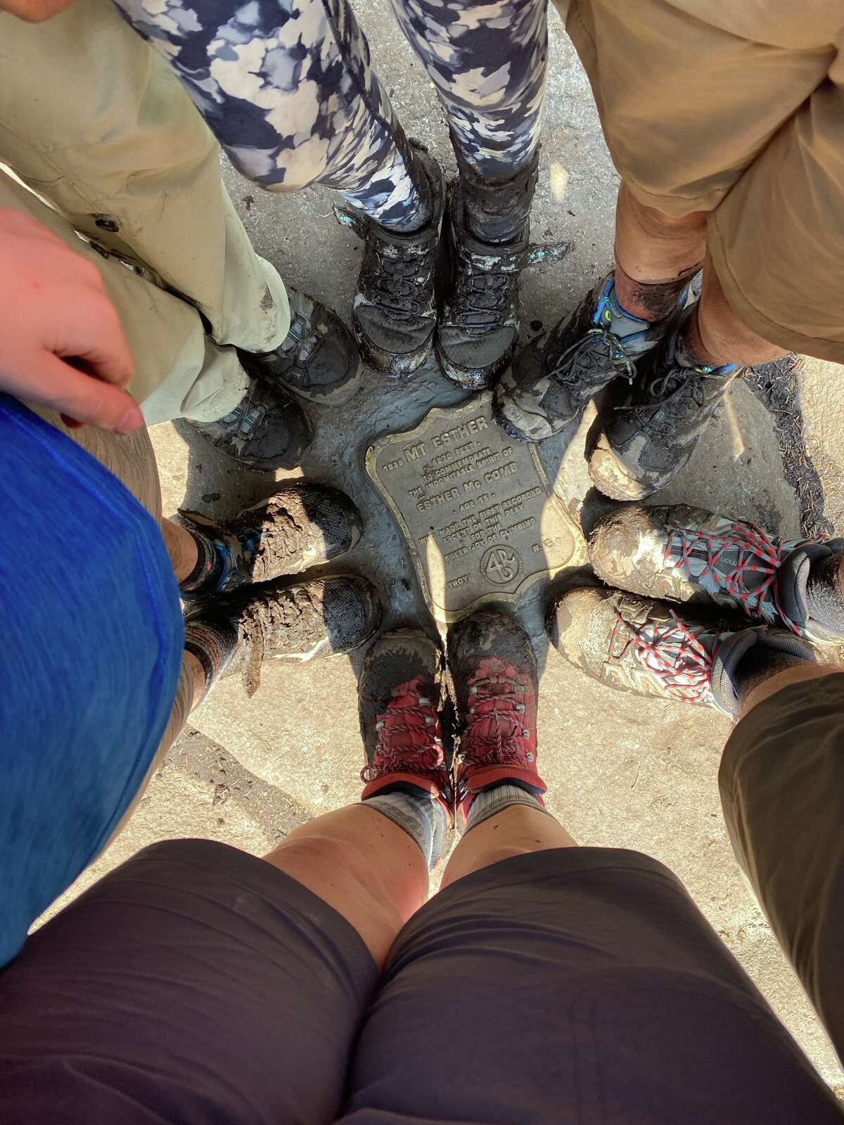 Hiking is more fun with friends. Six pairs of boots display their muddy glory on the summit of Esther Mountain, where a plaque commemorates the first climb of the mountain by 15-year-old Esther McComb.