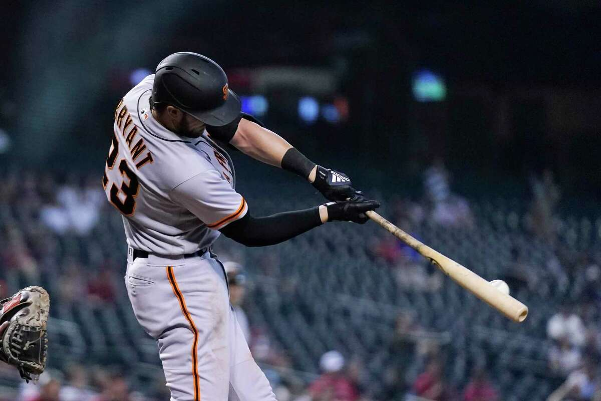San Francisco Giants' Kris Bryant hits an RBI double against the Arizona Diamondbacks during the 10th inning of a baseball game Thursday, Aug. 5, 2021, in Phoenix. The Giants won 5-4. (AP Photo/Ross D. Franklin)