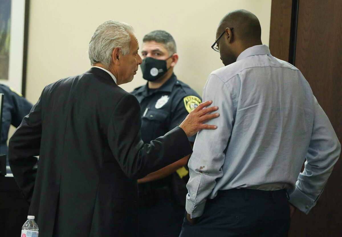 Defense attorney Joel Perez (center) talks with his client Otis McKane after both the defense and the state rested their case during the punishment phase of McKane's capital murder trial on Thursday. McKane was convicted last week of the 2016 killing of SAPD Detective Benjamin Marconi.