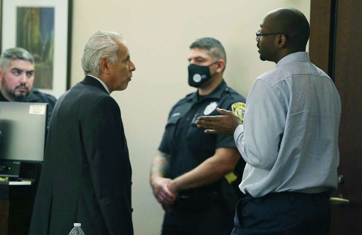 Defense attorney Joel Perez (left) talks with his client Otis McKane after both the defense and the state rested their case during the punishment phase of McKane's capital murder trial on Thursday. McKane was convicted last week of the 2016 killing of SAPD Detective Benjamin Marconi.