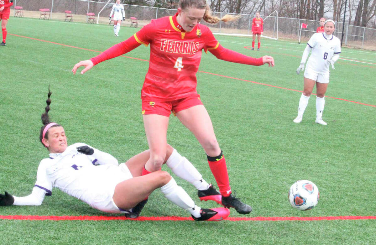 Ferris soccer player Grace VerHage (4) battles for the ball during action in the spring season.