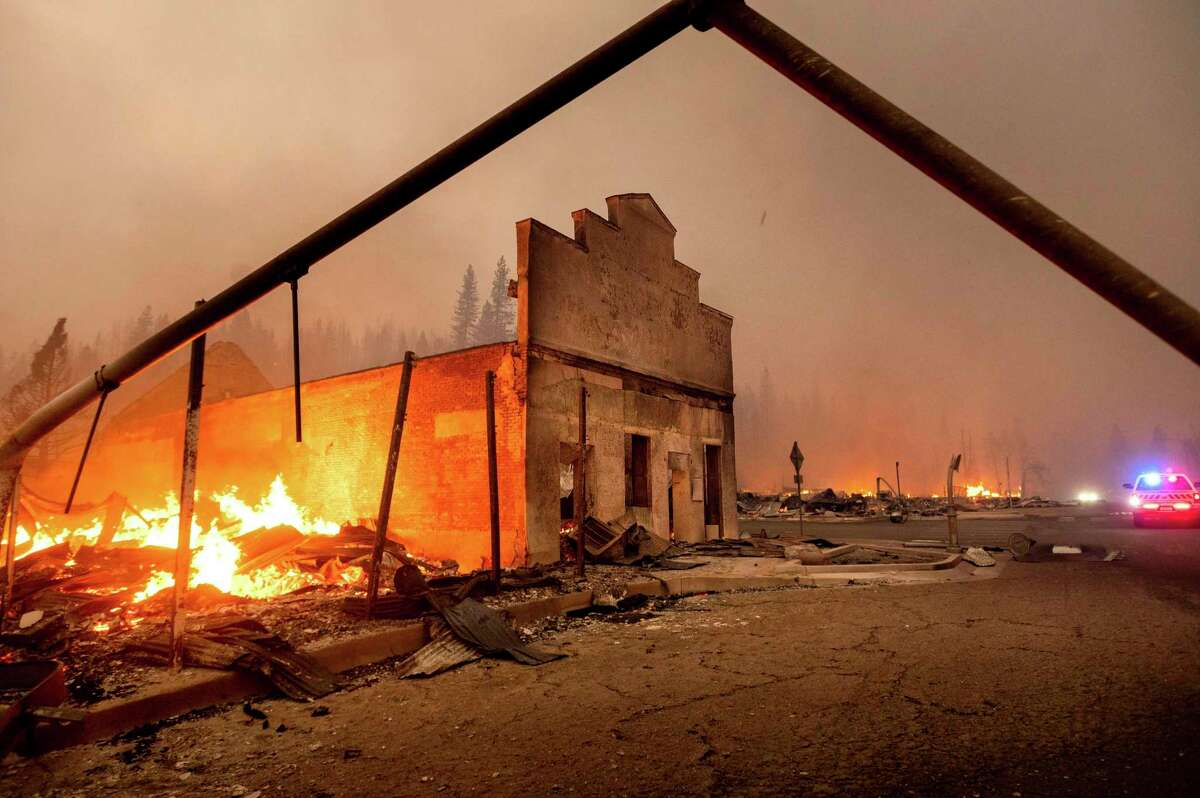 The Way Station bar burns as the Dixie Fire tears through the Greenville community of Plumas County, Calif. The fire leveled multiple historic buildings and dozens of homes in central Greenville.