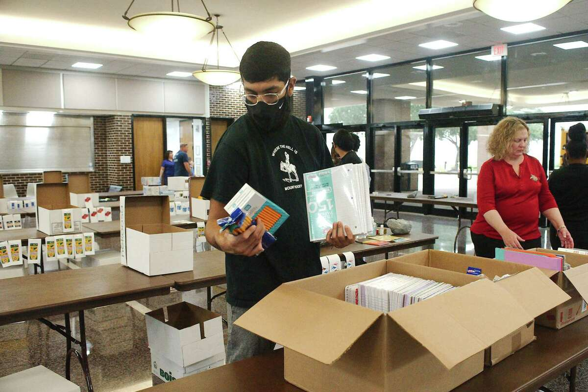 Cesar Ortiz sorts donated school supplies during the Fill the Bus School Supply Drive at the Pasadena Convention Center. The Aug. 3 event brought in $41,000 in cash donations as well as enough supplies to fill 14 pallets.