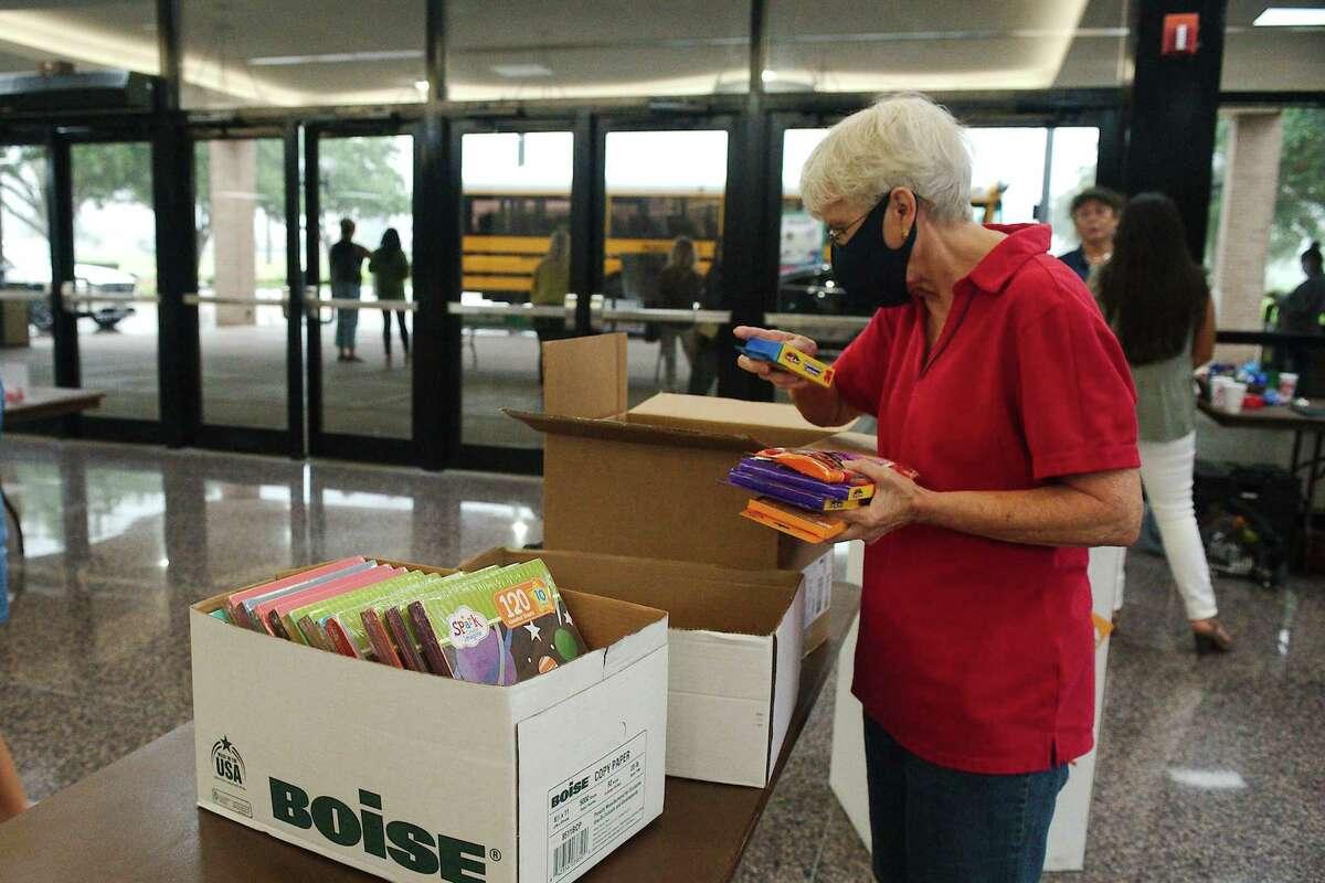Ida Ewing sorts donated school supplies.