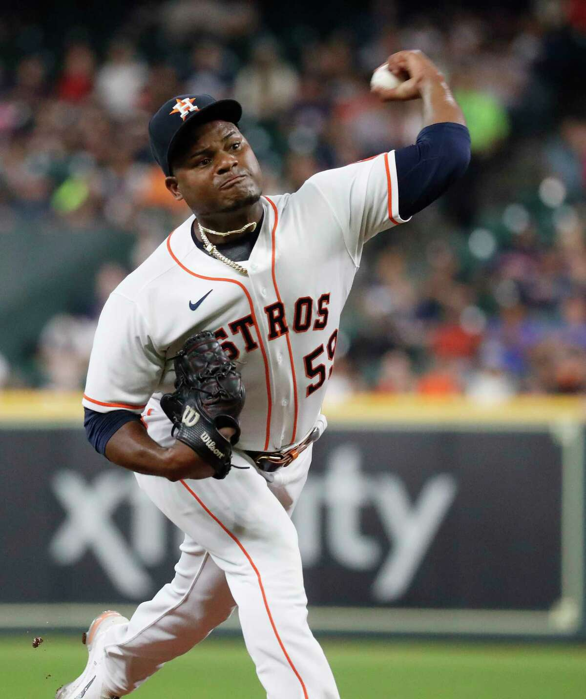 Houston Astros starting pitcher Framber Valdez (59) pitches during the first inning of an MLB baseball game at Minute Maid Park, Thursday, August 5, 2021, in Houston.