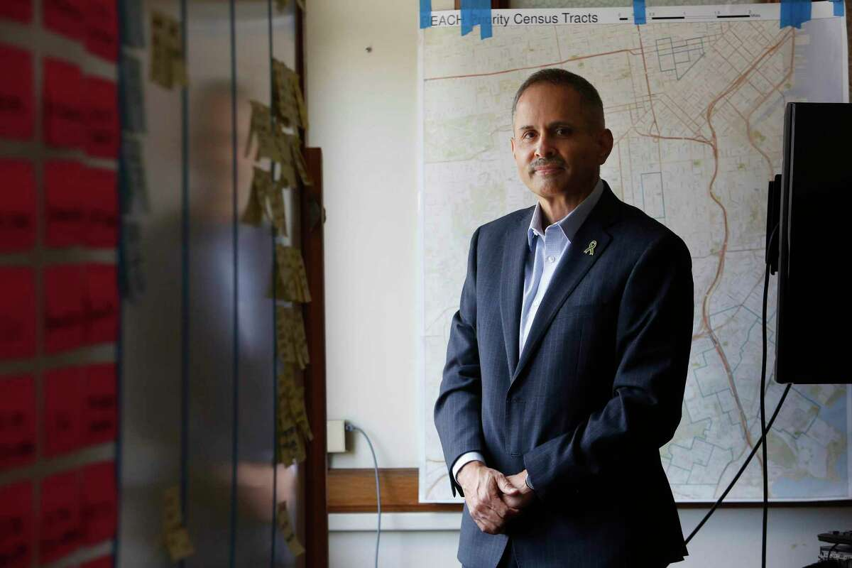 Tomás Aragon, director Population Health Division; Health Officer; City and County of San Francisco; stands for a portrait in his office at the Department of Public Health.