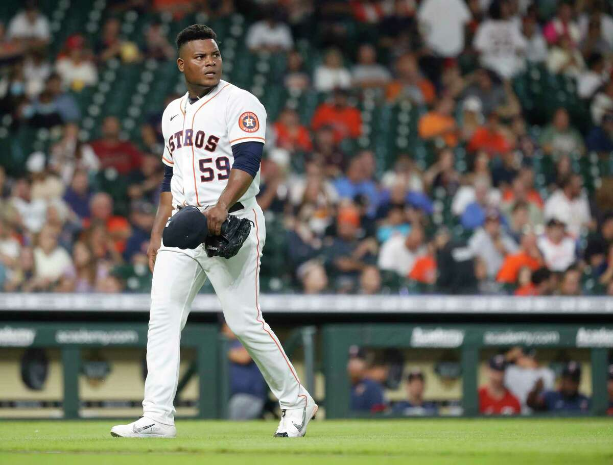 Houston Astros starting pitcher Framber Valdez (59) walks back to the dugout after Minnesota Twins Brent Rooker struck out to end the second inning of an MLB baseball game at Minute Maid Park, Thursday, August 5, 2021, in Houston.