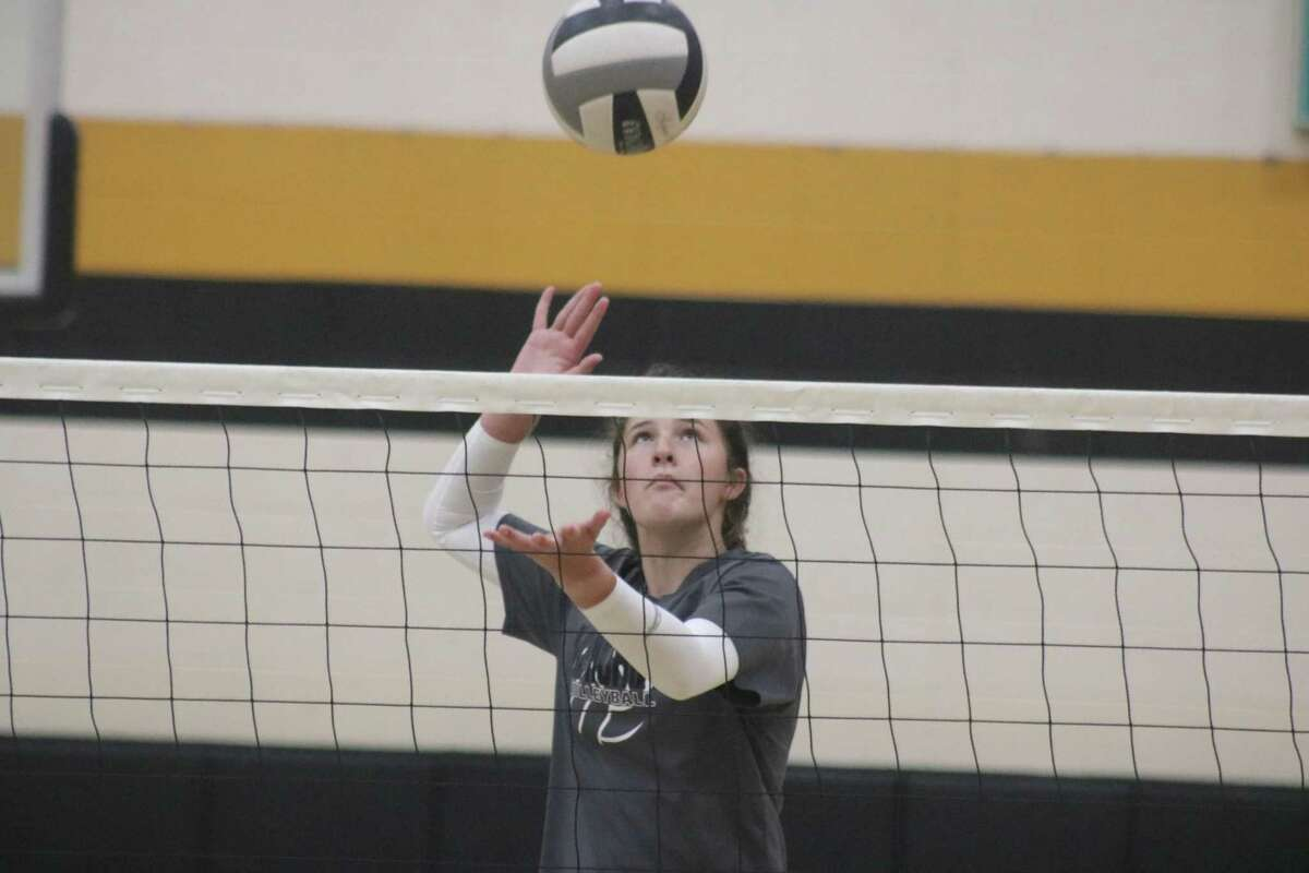 Memorial's Emma Carro tests the defense of her teammates on the other side of the net during Thursday's practice.