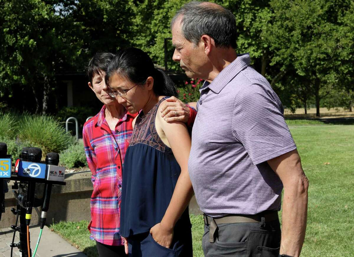 Philip Kreycik's mother Marcia Kreycik holds his wife Jen Yao, as father Keith Kreycik embraces them during a press conference at the Pleasanton Library on Thursday. Kreycik's remains were found this week after he was reported missing last month. Kreycik and Yao were married for four years.
