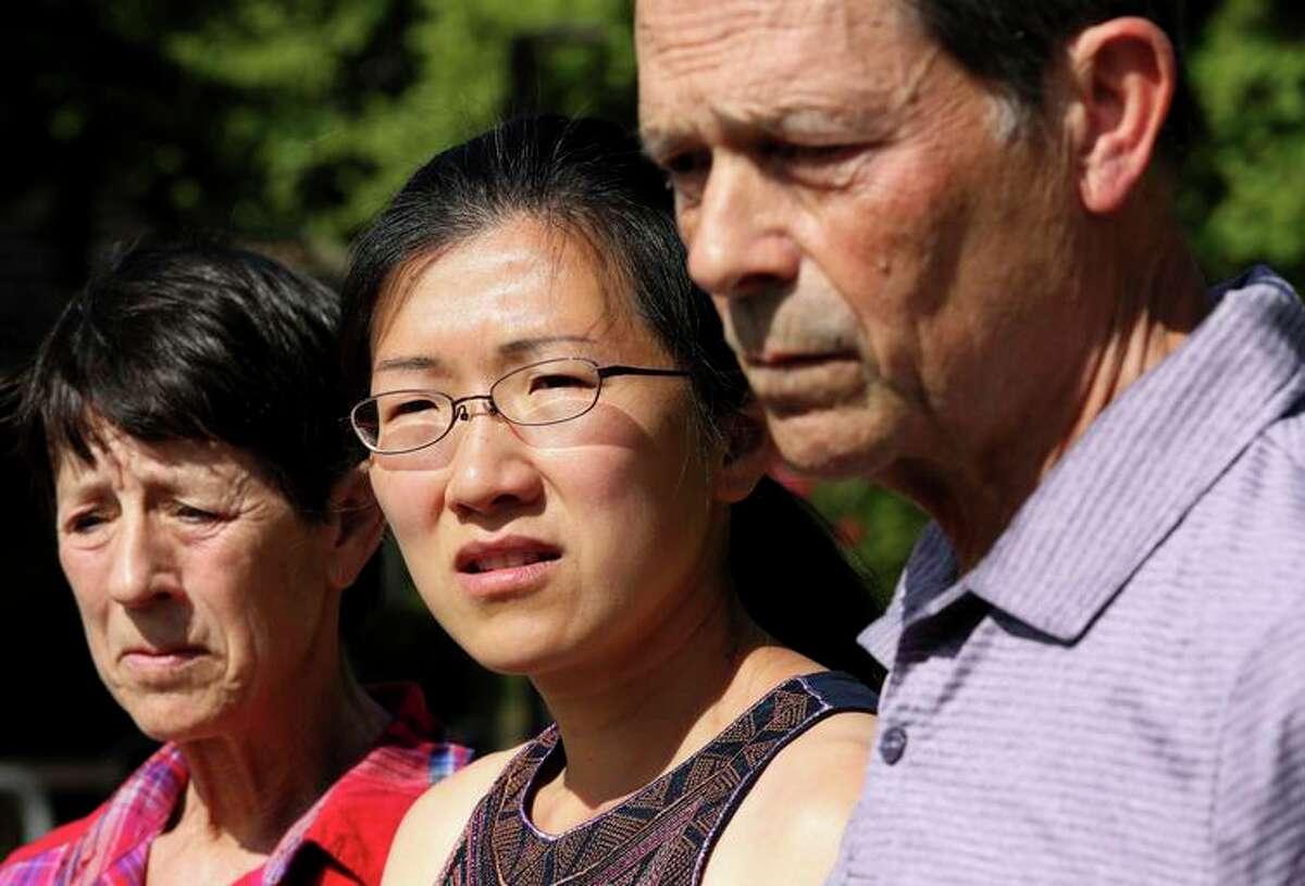 Philip Kreycik's mother Marcia Kreycik, wife Jen Yao and father Keith Kreycik at a press conference.