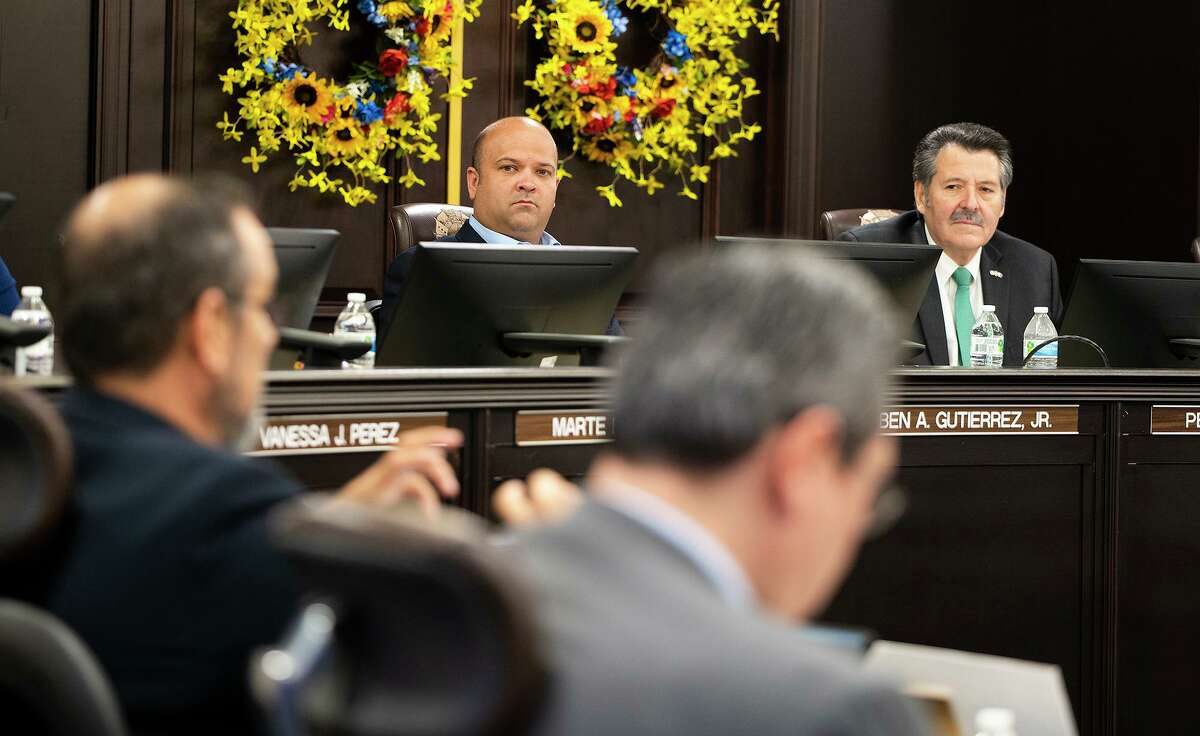 Laredo City Councilmember Ruben Gutierrez and Mayor Pete Saenza lisent as City Manager Robert Eads details the actions he has taken since the boil water notice took place, Monday, July 12, 2021, during a special city council meeting at City Hall.