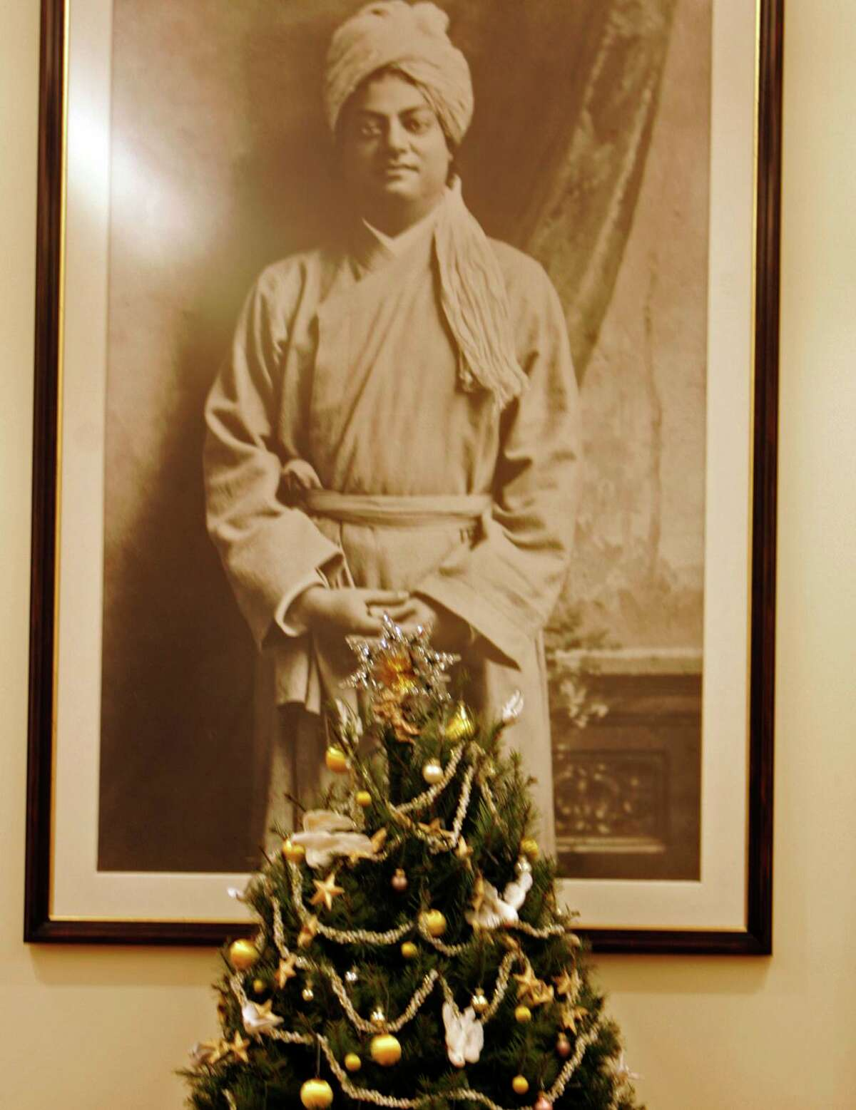 A photograph of Swami Vivekananda hangs behind a Christmas tree in 2005 at the Vedanta Society temple on Vallejo Street.