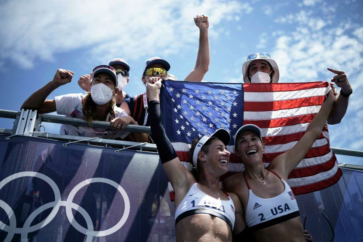 April Ross, left, of the United States, and teammate Alix Klineman celebrate winning a women's beach volleyball Gold Medal match against Australia at the 2020 Summer Olympics, Friday, Aug. 6, 2021, in Tokyo, Japan.