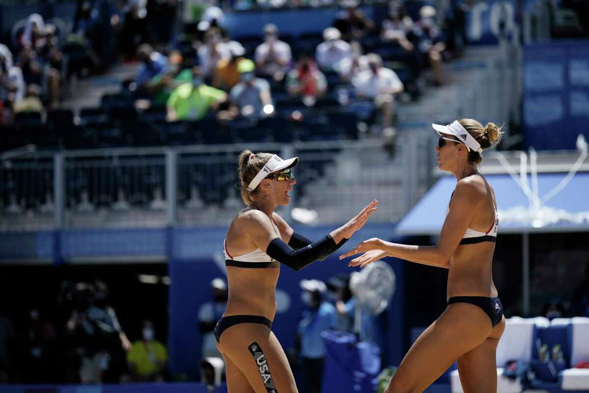 April Ross, left, of the United States, and teammate Alix Klineman celebrate a play during a women's beach volleyball Gold Medal match against Australia at the 2020 Summer Olympics, Friday, Aug. 6, 2021, in Tokyo, Japan.